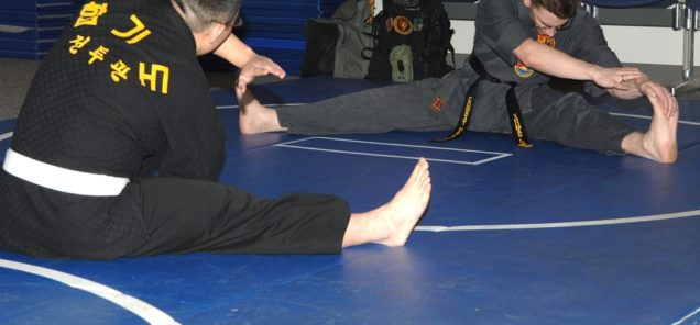 U.S. Air Force Staff Sergeant Thomas A. Locke, 92nd Communications Squadron, begins his Combat Hapkido class with stretches at the Fitness Center on Fairchild Air Force Base, Tuesday, February 5, 2008. SSgt Locke has been studying Combat Hapkido for five years, but has studied several other martial arts for over twelve. (U.S. Air Force Photo by Senior Airman Jocelyn A. Ford)(RELEASED)